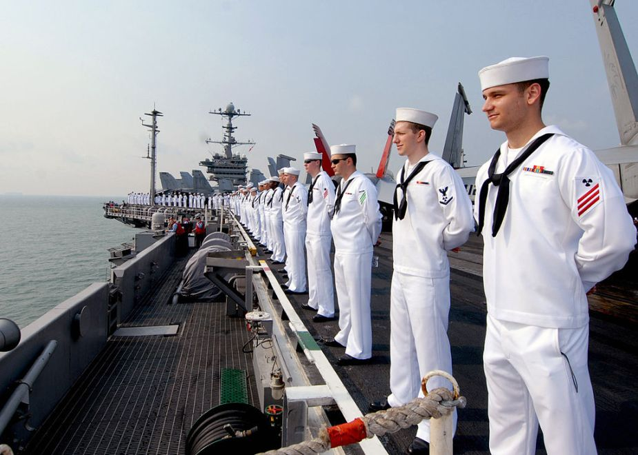 1024px-us_navy_090802-n-6720t-045_sailors_man_the_rails_aboard_the_aircraft_carrier_uss_george_washington_cvn_73_while_underway_off_the_coast_of_singapore