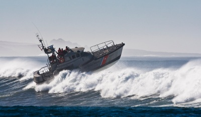 coast guard boat jumps the surf