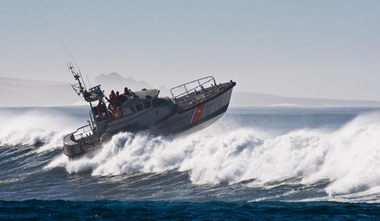 coast guard boat jumps the surf