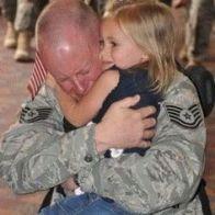 air force dad hugging daughter