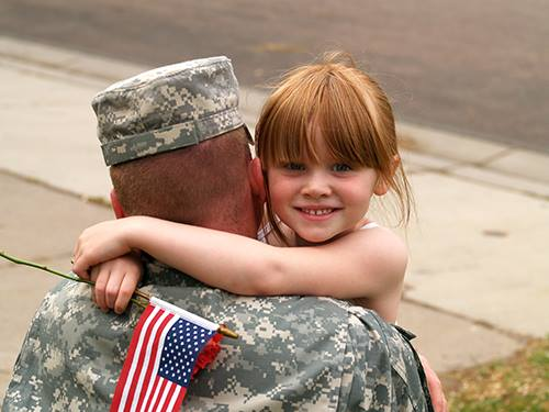army dad with daughter