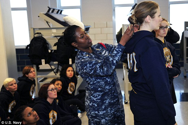 navy recruit division commander teaches women recruits how to wear their hair in uniform