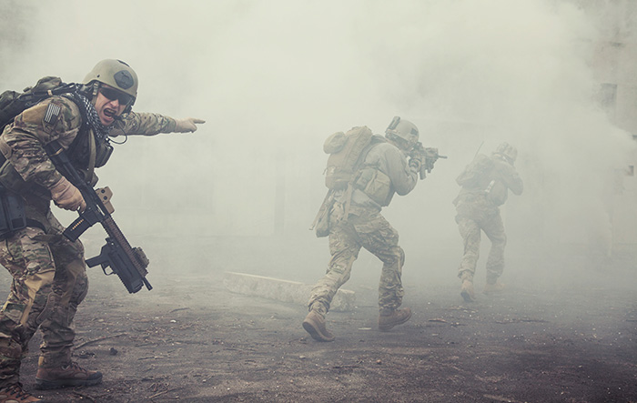 soldiers move into the smoke and fog of battle
