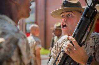 usmc drill instructor inspecting recruit's rifle