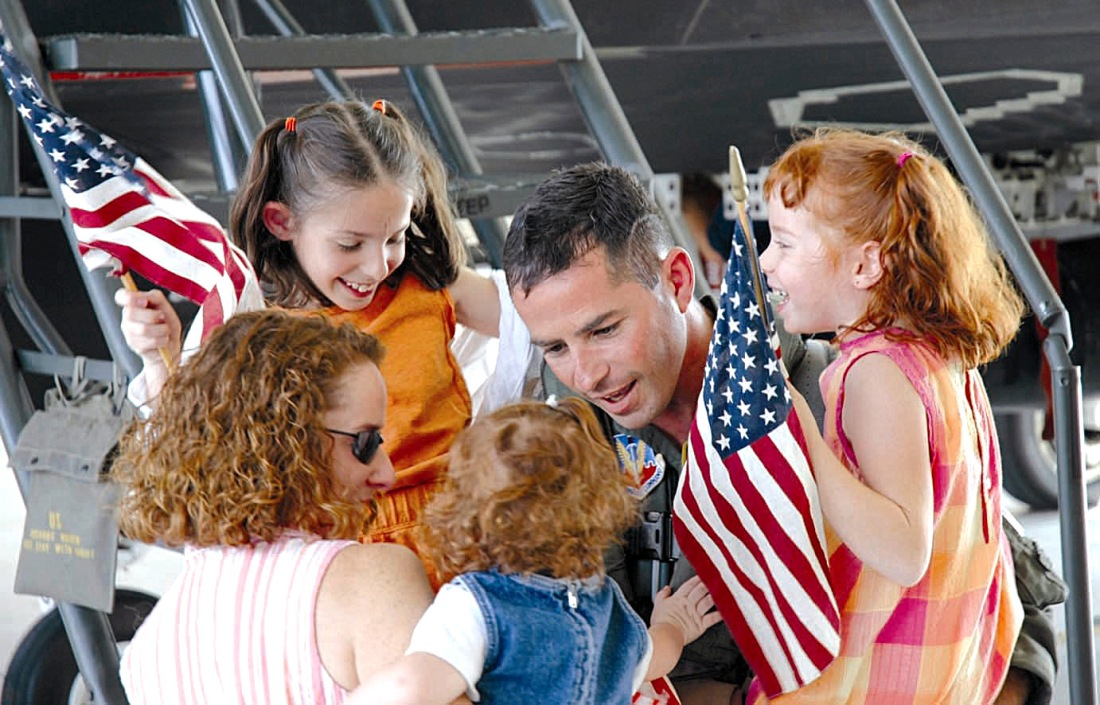 air force dad with wife and three daughters