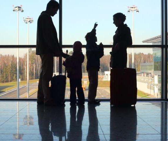 family-airport-window